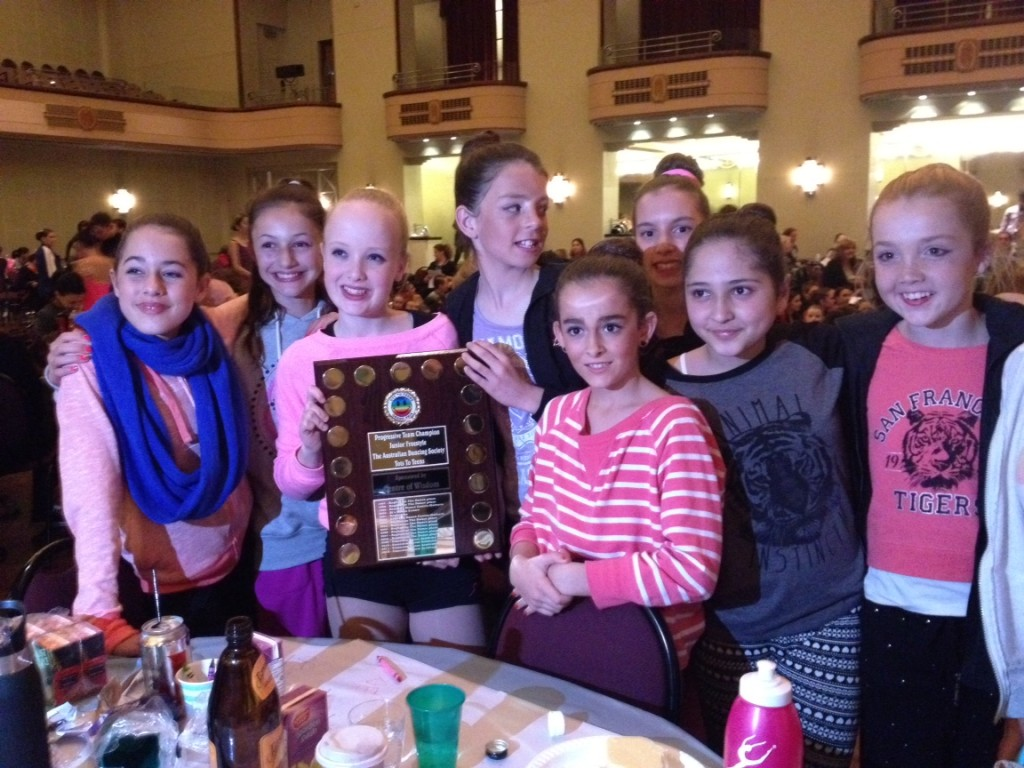 Junior funk team girls collecting their perpetual trophy for winning July 2013 competition.